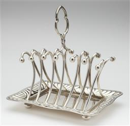 Sale 9123J - Lot 223 - An antique English silverplate 6 slice toast rack, Registered design number 260947 circa 1895, with attached crumb tray with shaped ...