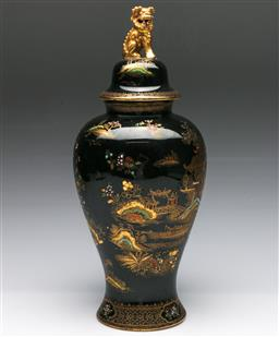 Sale 9173 - Lot 13 - A Wilton ware gilt decorated lidded urn with foo lion finial (H 40cm)