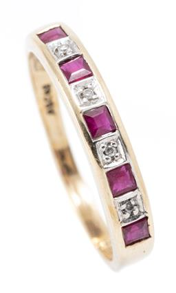 Sale 9182 - Lot 351 - A 9CT GOLD RUBY AND DIAMOND BAND; set across the top with 5 carre cut rubies between 4 single cut diamonds, width 3.6mm, size P, wt....