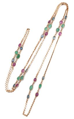 Sale 9209J - Lot 389 - A 14CT GOLD GEMSET NECKLACE; scroll chain interspersed with 10 groups of collet set oval cut ruby, emerald and blue sapphire, length...