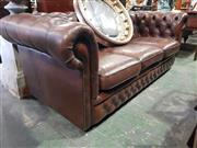 Sale 8814 - Lot 1080 - Gascoigne Brown Buttoned Leather Three Seater Chesterfield Lounge