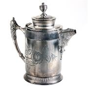 Sale 8000 - Lot 13 - A Britannia metal hot water jug of cylindrical form engraved with a rose.