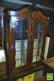Sale 8390 - Lot 1059 - A 19th Century Continental Walnut Armoire with Two astragal doors and sides inclosing a white interior (Key in Office)