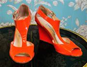 Sale 8577 - Lot 162 - A pair of Jimmy Choo orange patent leather wedge heels, size 41, Condition: Good some wear