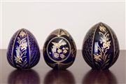 Sale 8774A - Lot 241 - A set of three Russian St Petersberg hand made etched blue and gilt eggs, tallest 11cm