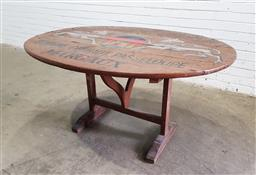 Sale 9126 - Lot 1071 - French Timber Folding Wine Tasting Table, the oval top painted with a fantastique vineyard with goat armorial (h:75 w:138 d:106cm)