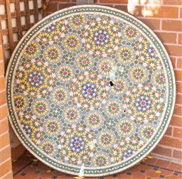 Sale 9190H - Lot 477 - A Moroccan mosaic round table top, imported from Casablanca (1999), Diameter 120cm (damages)