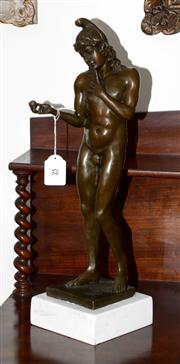 Sale 8088A - Lot 25 - A tall bronze figure of a male nude on white marble base - signed  54 cm tall