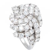 Sale 8915 - Lot 384 - AN 18CT WHITE GOLD DIAMOIND RING; love knot design set with 44 round brilliant cut diamonds totalling approx. 1.9ct, size P, wt. 5.96g.