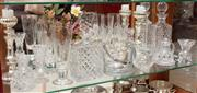 Sale 8926K - Lot 39 - A shelf lot of crystal and glass wares including a pair of candlesticks, decanters and glasses and an ice bucket. Tallest 25cm
