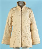 Sale 9090F - Lot 186 - A MONCLER QUILTED PUFFER JACKET; in a latte fabric with feather down, high neck and two side pockets  Size US 4/ AUS 10