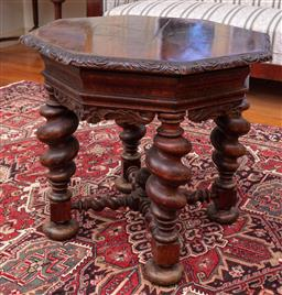 Sale 9190H - Lot 112 - A Russian octagonal heavily carved centre table with barley twisted legs and cross stretcher and finial base, Height 78cm x Diameter...