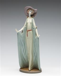 Sale 9253 - Lot 199 - A Lladro lady figure in sun hat (H:36cm) - losses to fingers
