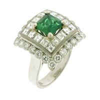 Sale 8221A - Lot 77 - 18ct White Gold Emerald and Diamond Cluster Ring; featuring a central emerald 1.5ct, surrounded by square and round brilliant cut di...