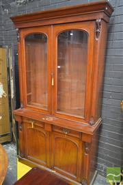 Sale 8267 - Lot 1076 - Victorian Mahogany Bookcase, with two arched glass panel doors, above two drawers & two panel doors (key in office)