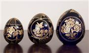 Sale 8774A - Lot 246 - A set of three graduated Russian St Petersberg hand made etched blue and gilt eggs, tallest 11cm