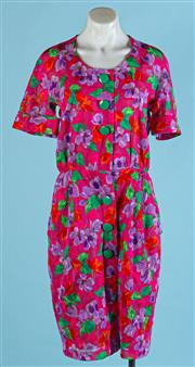 Sale 9090F - Lot 20 - AN AKRIS WAISTED SHORT SLEEVE DRESS; in a floral print on hibiscus pink ground with oversized green buttons, Size AUS 8