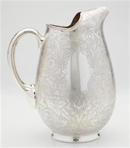 Sale 9123J - Lot 227 - A quality English Barker Ellis silverplate iced water jug with extensive embossed floral and foliate decoration. Ht: 18.5cm