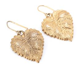 Sale 9182 - Lot 344 - A PAIR OF 9CT GOLD EARRINGS; leaf designs on shepherds hook fittings, size 30 x 16mm, wt. 2.69g.