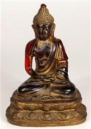 Sale 7968 - Lot 65 - Gilded Amber Figure of a Seated Buddha