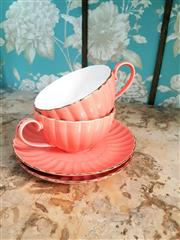 Sale 8500A - Lot 65 - A vintage pair of coral pink large cup & saucer set - Condition: Very Good - Measurements: Cup 13cm diameter x 7cm high / Saucer 21c...