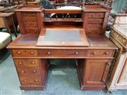 Sale 8814 - Lot 1081 - Victorian Mahogany Dickens Style Desk, with gallery back and eight trinket drawers, above a hinged writing slope with false drawer,...