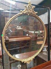 Sale 8917 - Lot 1078 - Round Gilt Mirror, with rope-twist border, having scroll caps above & below