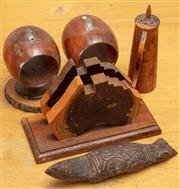 Sale 8984H - Lot 311 - A group of mulga wood including a napkin holder with aboriginal head, together with two barrel form napkin holders with kangaroo ado...