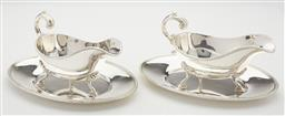 Sale 9123J - Lot 228 - A matching pair of quality English Barker Ellis silverplate gravy boats on matching oval trays with rope edge borders, each with