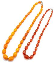 Sale 8915 - Lot 335 - TWO VINTAGE GRADUATED AMBER BEAD NECKLACES; 8-16mm ovoid butterscotch beads, 54cm, and 6-15mm faceted ovoid beads, 45cm.