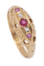 Sale 9012 - Lot 374 - AN ANTIQUE 18CT GOLD RUBY AND DIAMOND RING; set with 3 rubies and 2 rose cut diamonds on carved gallery and shoulders, size O, hallm...