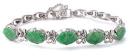 Sale 9124 - Lot 528 - A JADE BRACELET; 5 oval cabochon jade set plaques united by bow links to fancy links in rhodium plated silver to snap lock clasp and...