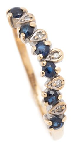 Sale 9128J - Lot 29 - A 9CT GOLD SAPPHIRE AND DIAMOND RING; wave form set across the top with 6 round cut blue sapphires and 5 single cut diamonds in drop...