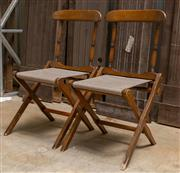 Sale 8677A - Lot 79 - A pair of campaign chairs with striped upholstery