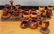 Sale 8984H - Lot 313 - A group of mulga wood including eight napkin rings, six egg cups together with a set of four egg cups on purposed stand