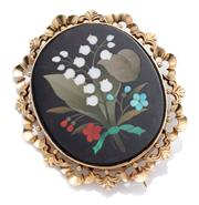 Sale 9012 - Lot 373 - A 14CT GOLD PIETRA DURA BROOCH; black oval plaque inlaid with hardstones featuring bouquet of flowers to scrolling gold border and e...
