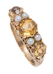 Sale 9012 - Lot 358 - A VINATGE 9CT GOLD CITRINE AND PEARL RING; set on the half hoop with 3 round cut citrines between 4 seed pearls on a scroll gallery...