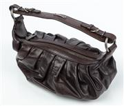Sale 9027F - Lot 83 - A vintage Bally hobo bag in brown leather, with buckle detail and dust bag, internal tag no OSDK