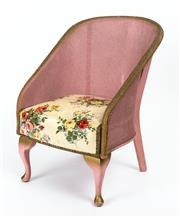 Sale 9015J - Lot 53 - A classic 1940's Lloyd Loom childs chair painted pink with gilt embellishments. The seat upholstered in red and yellow rose pattern ..