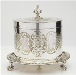 Sale 9123J - Lot 230 - A good antique silverplate large biscuit barrel C: 1890's, the engraved lid with a bold finial, the body with an elaborate scrolled ..