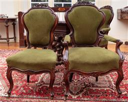 Sale 9190H - Lot 113 - A set of four Russian (St Petersberg) carved oak shaped back dining chairs raised on castors, to include two carvers, with green vel...
