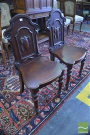 Sale 8335 - Lot 1080 - Pair of Victorian Mahogany Hall Chairs, with shield backs & on turned legs