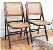Sale 9070H - Lot 54 - Two folding cane back chairs, height of back 84cm