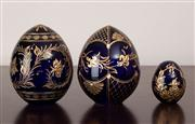 Sale 8774A - Lot 328 - A set of three Russian St Petersberg handmade etched blue and gilt eggs, tallest 11cm