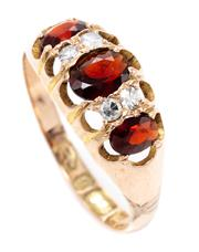 Sale 8905J - Lot 379 - A VICTORIAN STYLE 9CT GOLD GEMSTONE RING; set with 3 oval cut garnets and 4 single cut diamonds, part shank replaced with hallmarked...