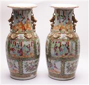 Sale 9032C - Lot 701 - Good Pair Of Famile Rose Chinese Vases Decorated With Characters And Supported By Gilt Zoomorphic Mounts H: 46cm (Crack to bottom)