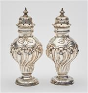 Sale 9085S - Lot 30 - Pair of English Sterling Silver Pepper Shakers, each hallmarked London 1908, each height 9.5cm