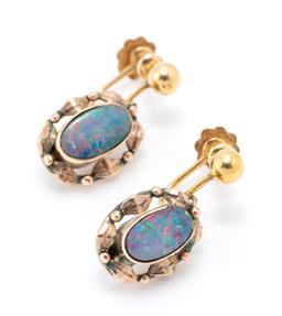 Sale 9221 - Lot 333 - A PAIR OF VINTAGE 9CT GOLD OPAL EARRINGS; oval triplets to foliage surrounds in the Wager style, converted to screw back fittings, s...