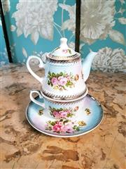Sale 8500A - Lot 69 - A Tea for One porcelain set featuring lovely blue floral pattern & gilded accents - Condition: As New - Measurements: 18cm high x 15...