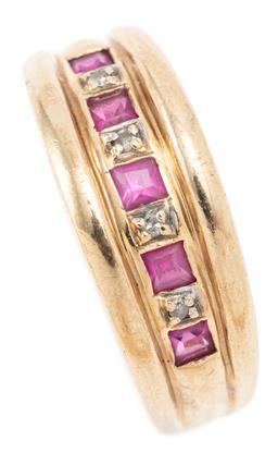 Sale 9128J - Lot 14 - A 9CT GOLD DIAMOND AND STONE SET RING; tapered band set across the top with 5 carre cut synthetic rubies and 4 single cut diamonds,...